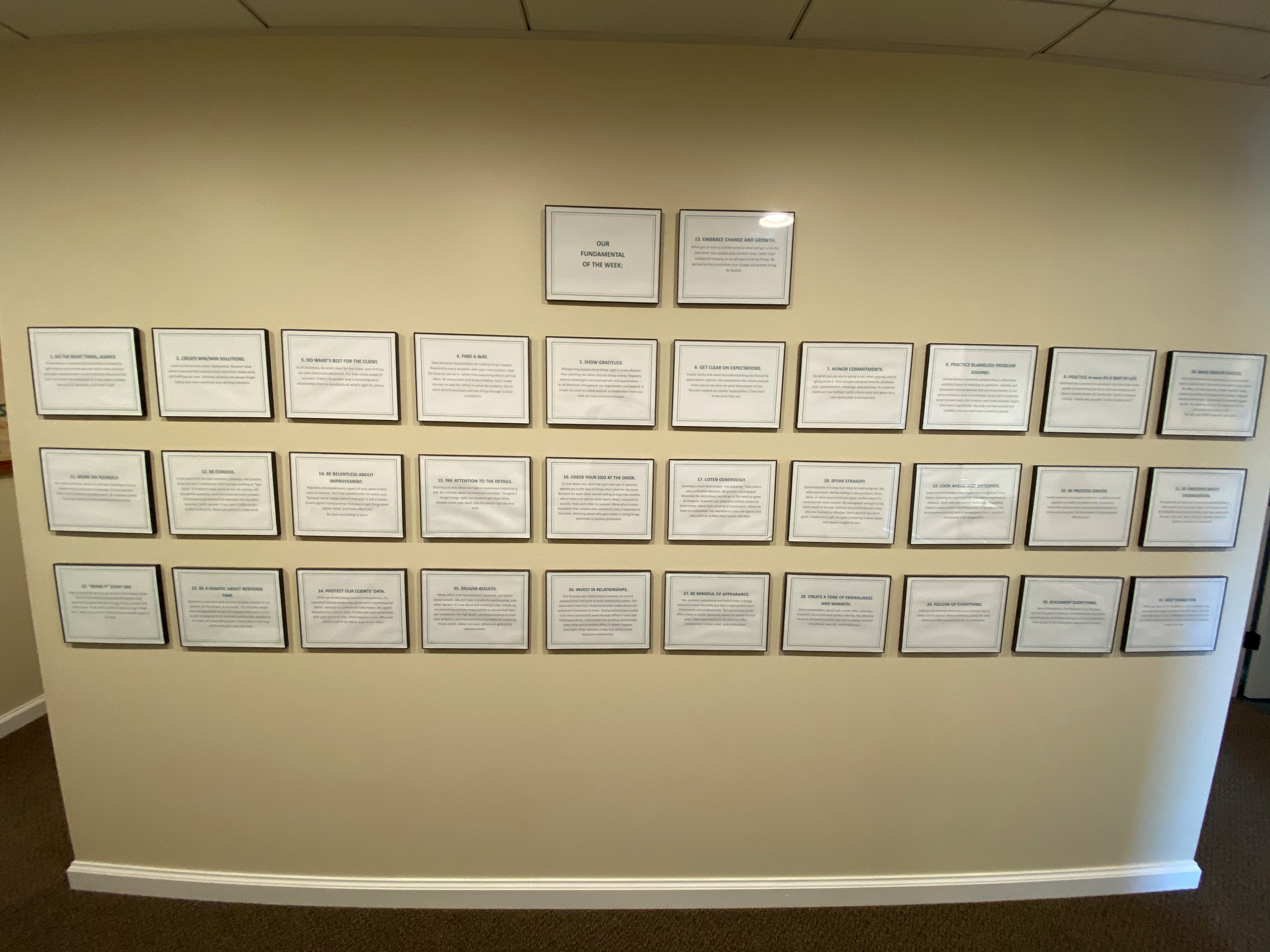 31 Fundamentals framed and hanging on wall.